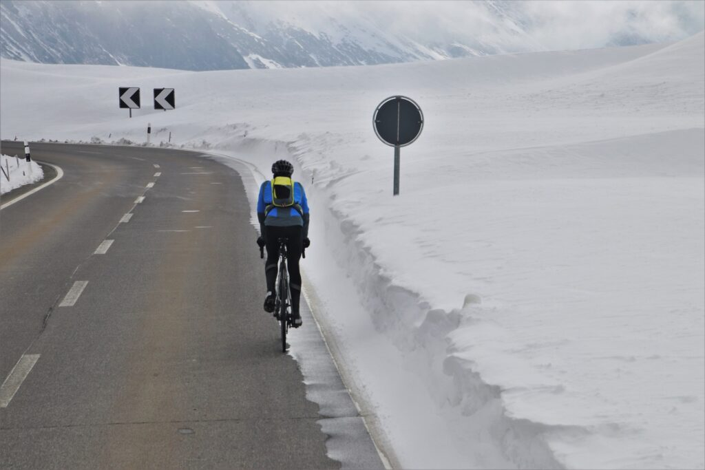 Man cycles in snow
