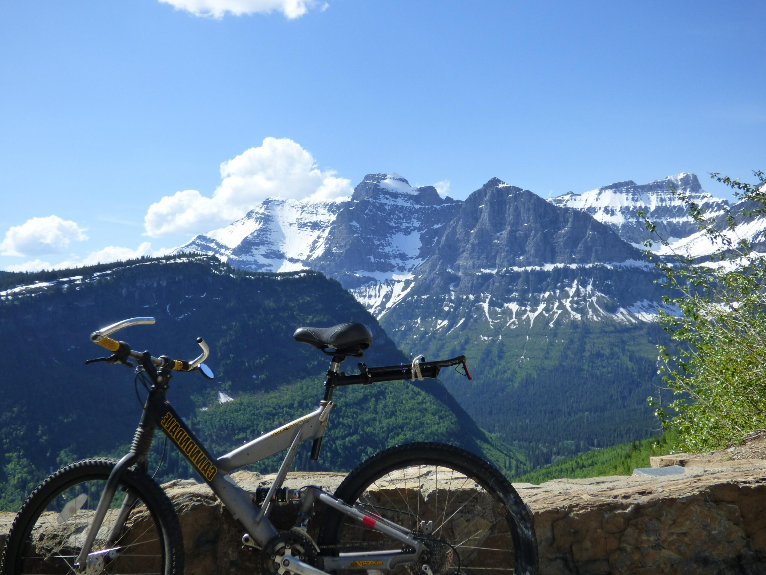 Bike parked beside Going-to-the-sun road with mountain in background
